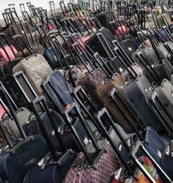 Состоялся необычный чемоданный аукцион LOT