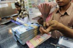 С 1 июля в Индонезии запрещено использовать любую иностранную валюту, в том числе и доллары США