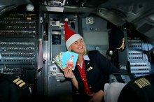 Новогодняя акция TEZ TOUR и «Белавиа»: подпиши поздравительные открытки близким на борту самолета!