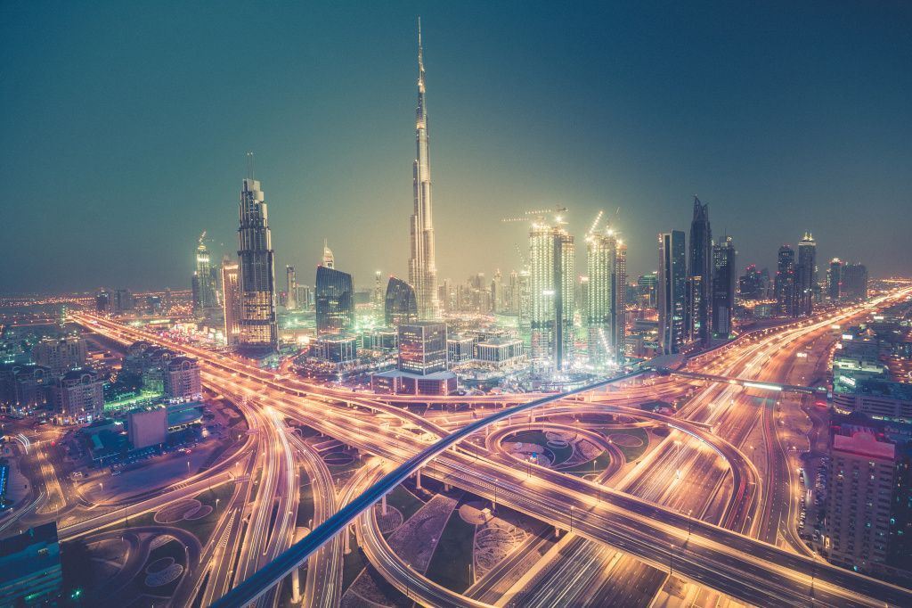 Dubai skyline at night with beautiful city with lights close to it's busiest highway shutterstock_427109158.jpg